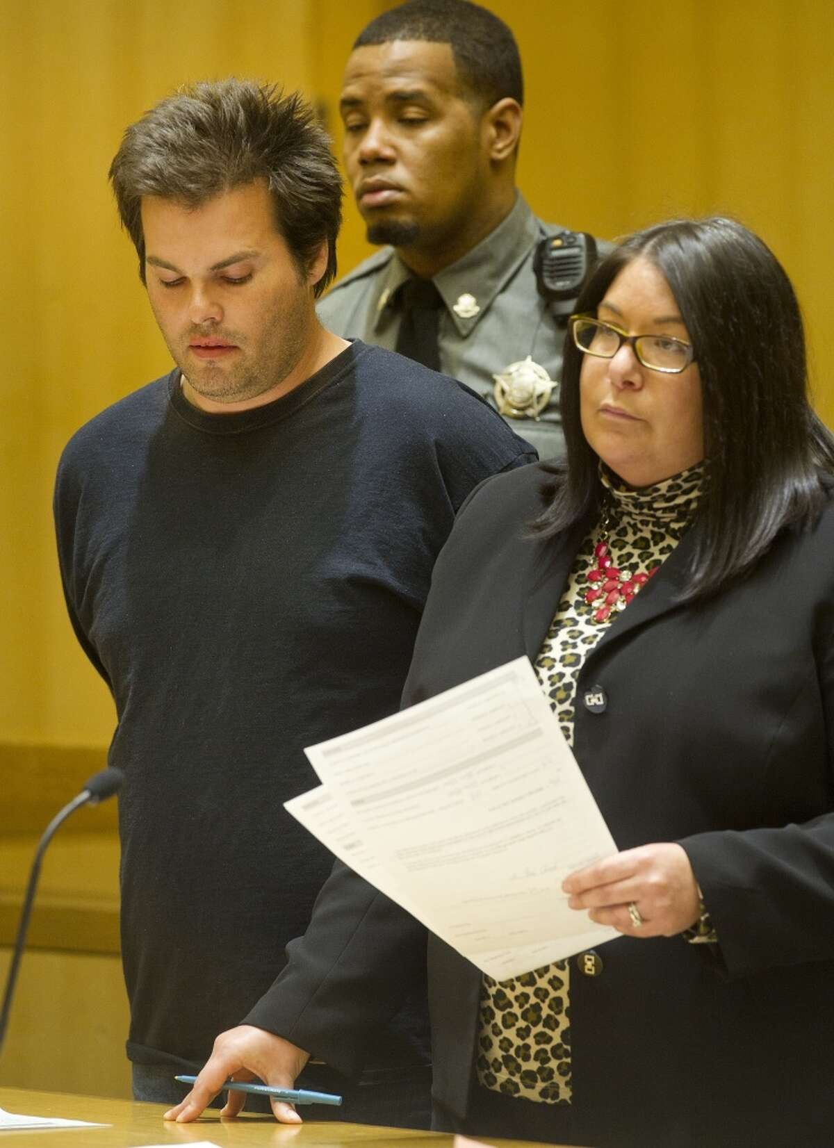 Timothy Anderson, 42, stands with attorney April Pramer as he is arraigned in State Superior Court in Stamford, Conn., on Tuesday, March 24, 2015, on charges of unlawful restraint, disorderly conduct and two charges of assault.