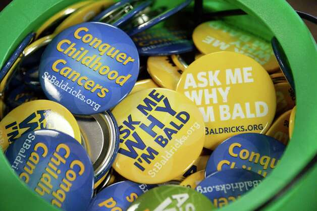Buttons at the St. Baldrick's Foundation fundraiser to find cures for childhood cancers at the College of Saint Rose Thursday March 26, 2015, in Albany, NY.  (John Carl D'Annibale / Times Union) Photo: John Carl D'Annibale / 00031166A