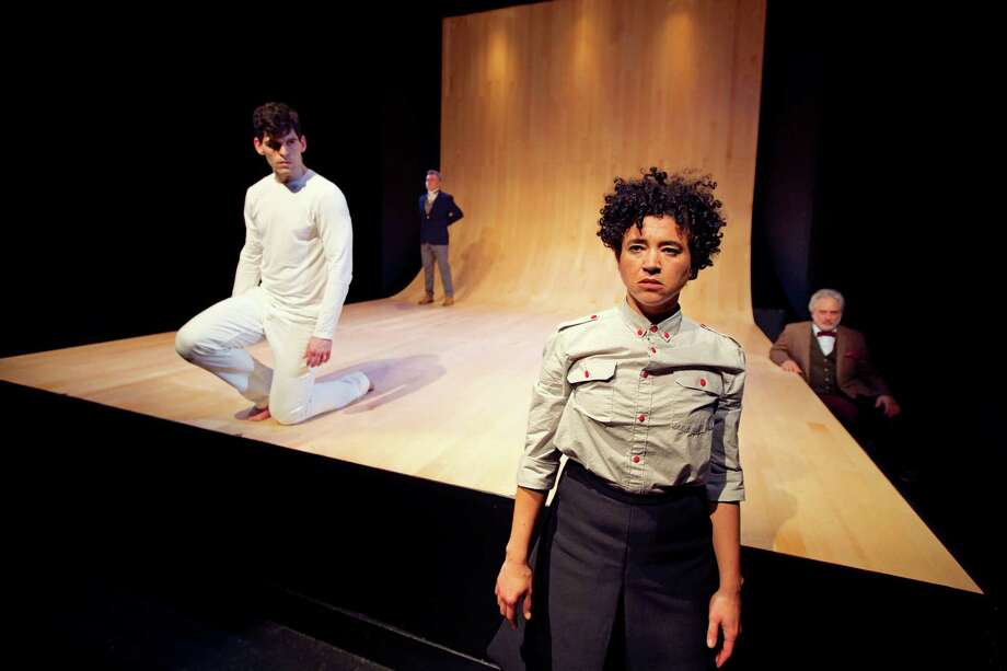 """Antigone (Rami Margron, right front) accepts Kreon's sentence of death in Shotgun Players' """"Antigonick,"""" with Parker Murphy as Nick (left), Kevin Clarke as Kreon and David Sinaiko as the Chorus. Photo: Pak Han / ONLINE_YES"""