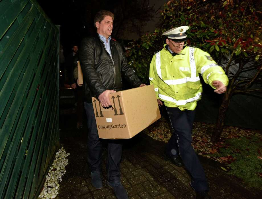 """Investigators carry boxes from the apartment of Germanwings airliner jet co-pilot Andreas Lubitz, in Duesseldorf, Germany. On Thursday, French prosecutors said Lubitz, the co-pilot of Germanwings Flight 9525, """"intentionally"""" crashed the jet into the side of a mountain Tuesday in the French Alps. Photo: Martin Meissner /Associated Press / AP"""