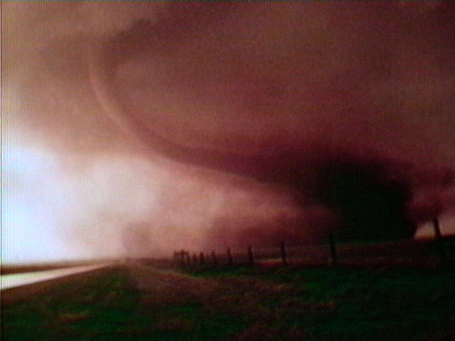 """An encroaching tornado is part of """"The Terrible Uncertainty of the Thing Described"""" video installation. Photo: Doug Hall / S.f. Museum Of Modern Art / ONLINE_YES"""