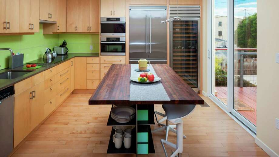 The kitchen includes a Sub-Zero wine chiller and energy efficient appliances. Photo: Peter Lyons Photography / ONLINE_CHECK