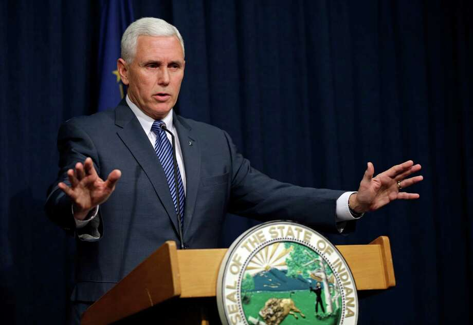 Indiana Gov. Mike Pence at a news conference at the Statehouse in Indianapolis, March 26, 2015. (AP Photo/Michael Conroy) Photo: Michael Conroy, STF / AP