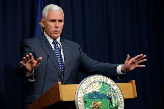 Indiana Gov. Mike Pence holds a news conference at the Statehouse in Indianapolis, Thursday, March 26, 2015. Pence has declared a public health emergency in response to the HIV epidemic in Scott County.  Seventy two cases of HIV have been confirmed in the southern Indiana county. (AP Photo/Michael Conroy)