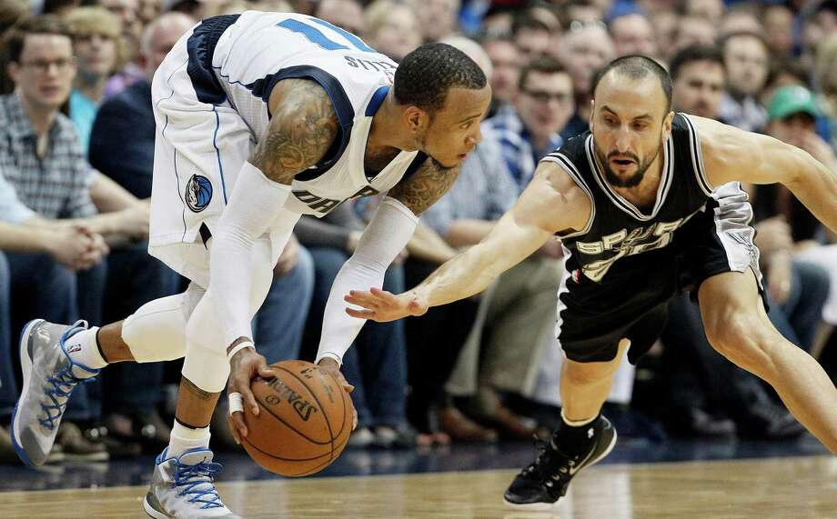 Dallas Mavericks guard Monta Ellis, left, looks for room against San Antonio Spurs guard Manu Ginobili, right, during the second half of an NBA basketball game, Tuesday, March 24, 2015, in Dallas. Ellis had 38 points in the game. Dallas won 101-94. Photo: Brandon Wade /Associated Press / FR168019 AP