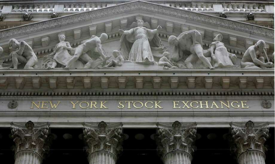 FILE - This Oct. 2, 2015 file photo shows the facade of the New York Stock Exchange, in New York. U.S. stocks are edging lower in midday trading Thursday, March 26, 2015, extending the market's losses to a fourth day. (AP Photo/Richard Drew, File) ORG XMIT: NYBZ182 Photo: Richard Drew / AP