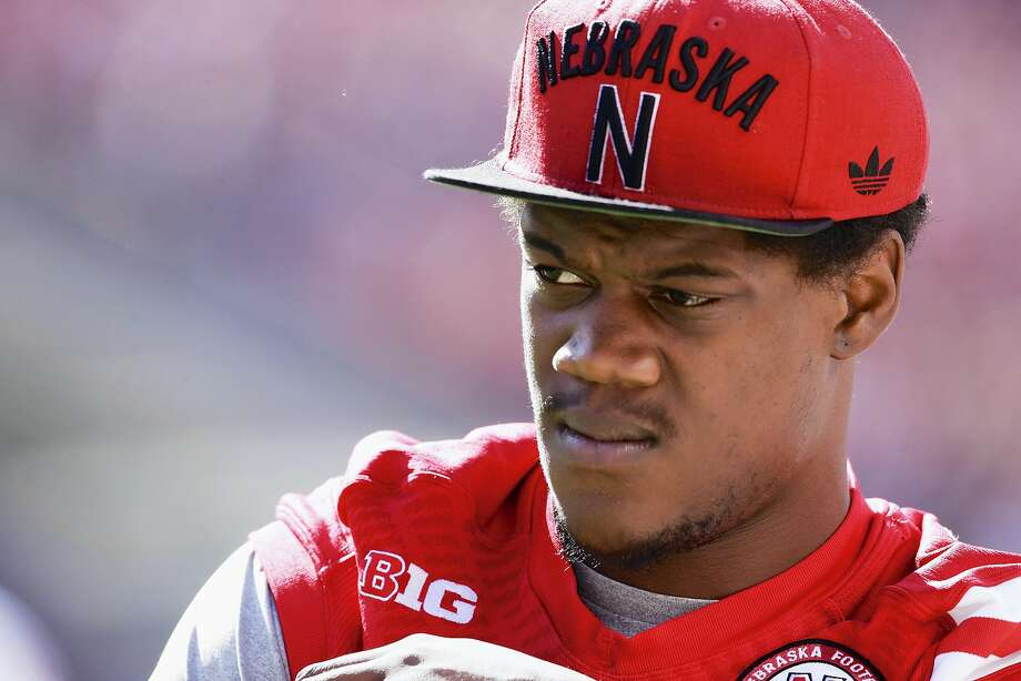 In a Sept. 6, 2014, file photo then-Nebraska defensive end Randy Gregory wears street clothes before an NCAA college football game against McNeese State in Lincoln, Neb. Randy Gregory says he's tested positive for marijuana at the NFL scouting combine last month and that he failed two drug tests at Nebraska last year. Gregory disclosed his marijuana use in an interview with NFL Media on Wednesday, March 25, 2015.  Gregory went into February's scouting combine projected to be among the top 10 picks  (AP Photo/Nati Harnik, File) Photo: Nati Harnik, Associated Press