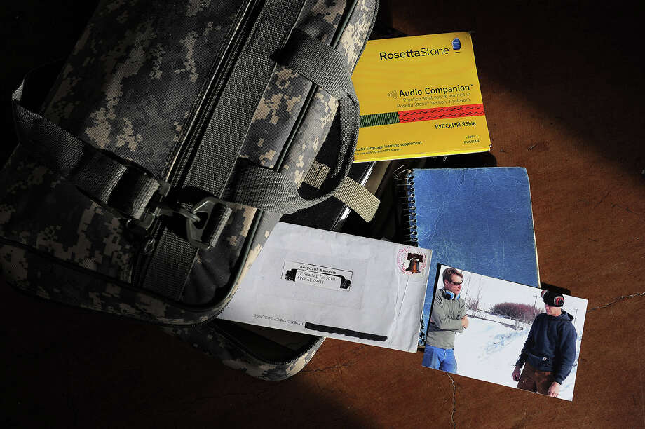 This camouflage case, containing a journal, photographs and other personal items, was received by Kim Harrison, a friend of Bowe Bergdahl, after Bergdahl vanished in Afghanistan in 2009. Harrison said she showed his personal effects, his journal and his emails to The Washington Post so people would better understand Bergdahl. Illustrates SOLDIER (category a), by Stephanie McCrummen © 2014, The Washington Post. Moved Wednesday, June 11, 2014. (MUST CREDIT: Washington Post photo by Matt McClain)