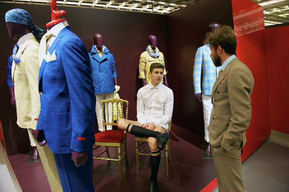 Models chat at an Isaia boutique in Florence, Italy. Isaia sports jackets that were close to $3,000 at Barneys in New York were 1,000 euro. Photo: New York Times File Photo / NYTNS