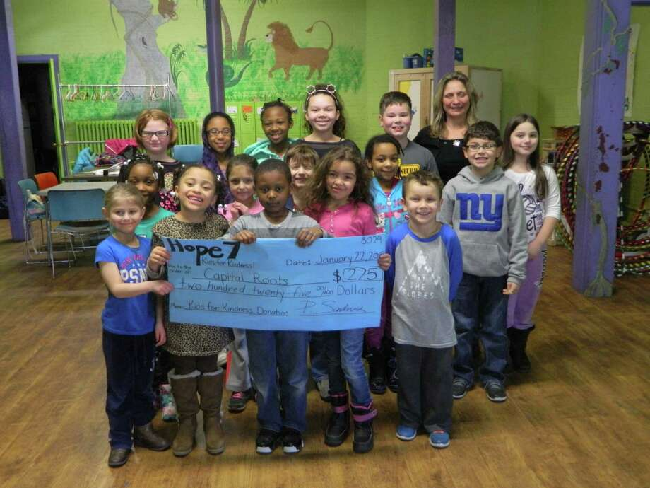 Kids for Kindness Staff at Capital Roots, formerly Capital District Community Gardens, were recently presented with a $225 donation check from the Kids for Kindness Club at the Hope 7 Community Center in Troy. Students in the center's afterschool program raised funds for the 40-year-old organization during the holiday season by selling hand-crafted items to the community. The money raised will support Capital Roots' Squash Hunger program, a food donation initiative that collects and distributes more than 28 tons of fresh produce to the region's food pantries and shelters each year. The Squash Hunger program, along with Capital Roots' many other programs aimed at nourishing healthy communities in the Capital Region, operates out of the Urban Grow Center in Troy, a regional facility focused on urban agriculture and produce distribution to four counties. Learn more at www.capitalroots.org.