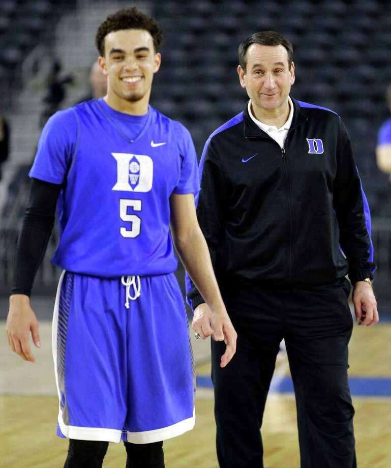 Duke guard Tyus Jones (5) and head coach Mike Krzyzewski share a laugh during practice for the NCAA South Regional at NRG Stadium on Thursday, March 26, 2015, in Houston. Photo: Brett Coomer, Houston Chronicle / © 2015 Houston Chronicle