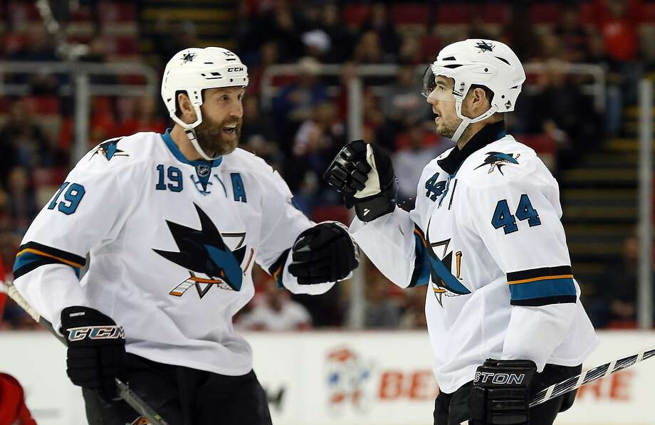 San Jose Sharks defenseman Marc-Edouard Vlasic (44) celebrates his goal against the Detroit Red Wings with Joe Thornton (19) during the first period of an NHL hockey game in Detroit on Thursday, March 26, 2015. Photo: Paul Sancya, Associated Press
