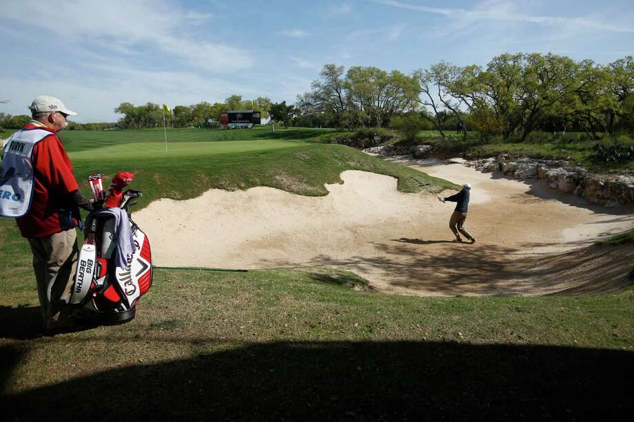 Jim Furyk hits out of the sand trap at the first green during the opening round of the Texas Open Thursday March 26, 2015. Photo: William Luther, Staff / San Antonio Express-News / © 2015 San Antonio Express-News