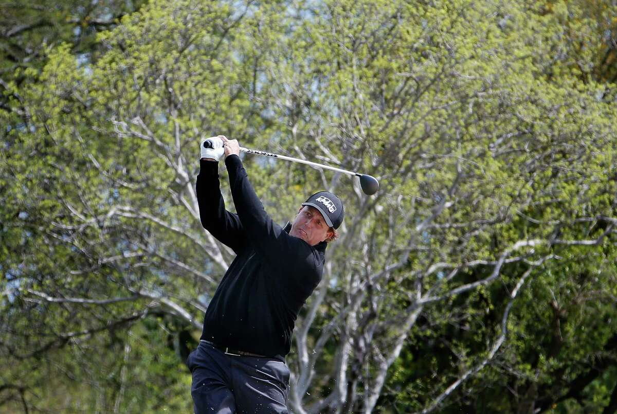 SAN ANTONIO, TX - MARCH 26: Phil Mickelson takes his second shot on the eighth hole during round one of the Valero Texas Open at TPC San Antonio AT&T Oaks Course on March 26, 2015 in San Antonio, Texas. (Photo by Christian Petersen/Getty Images)