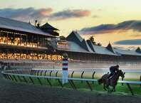 Tracey Wilkes gives Birdmaker a workout Monday morning, Aug. 18, 2014, as the mist overtakes the main track at Saratoga Race Course in Saratoga Springs, N.Y. (Skip Dickstein/Times Union)