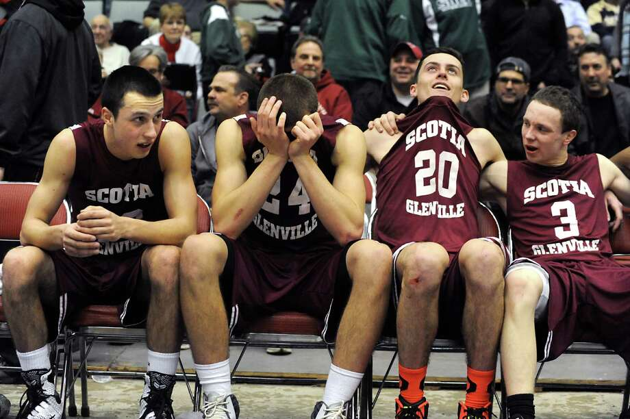 Scotia Glenville players, from left, Joe Almond, Joe Cremo,  Michael Palleschi and Scott Stopera gather their emotions after defeating Greece Athena in the Class A boys' basketball state final on Sunday, March 22, 2015 in Glens Falls, N.Y. (Lori Van Buren / Times Union) Photo: Lori Van Buren / 10031112A