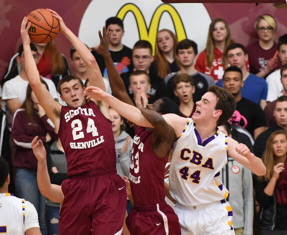 Christian Brothers Academy's Emmett Dunn (44) is beat to a rebound by Scotia-Glenville's Joe Cremo (24) and Diamond Corker (33) in the New York State Class A Regional final at Colgate University, Hamilton, N.Y., Saturday March 13, 2015. (Scott Schild / Special to the Times Union) ORG XMIT: 94825 Photo: SCOTT SCHILD