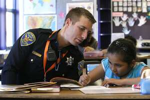 Cop throws the book at Bayview kids as reading tutor - Photo