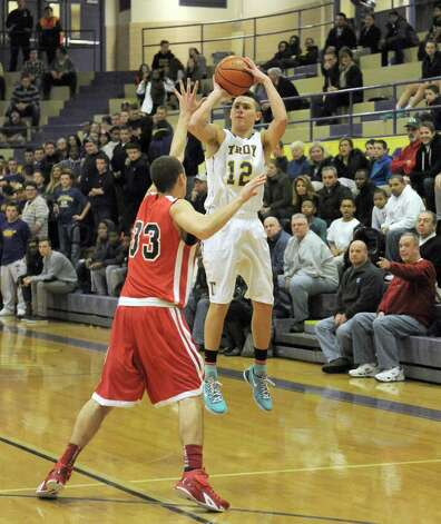 Troy's Zach Radz puts uo a three point shot during their boy's high school basketball game against Albany Academy on Wednesday Dec. 17, 2014 in Troy ,N.Y.  (Michael P. Farrell/Times Union) Photo: Michael P. Farrell / 00029859A