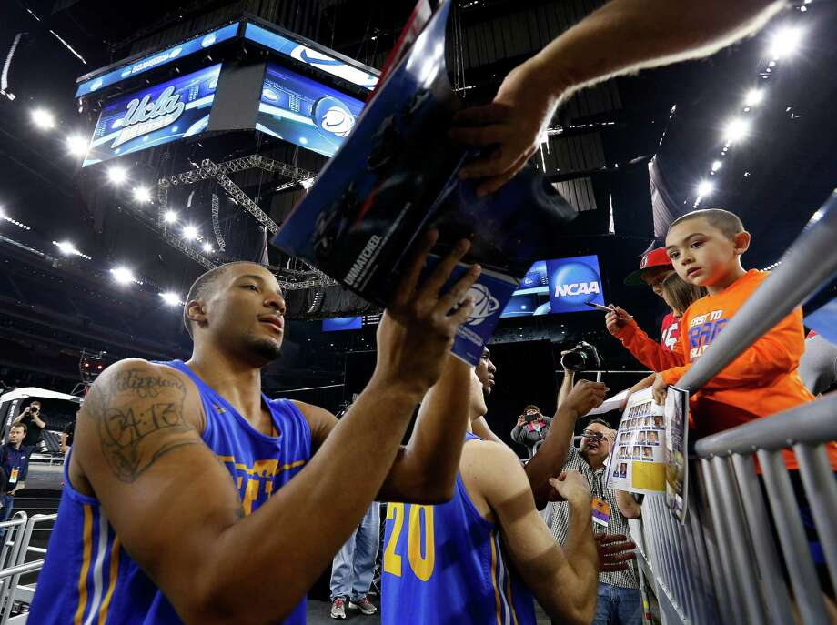 UCLA guard Norman Powell is a hit with the youngsters at NRG Stadium on Thursday and with his younger teammates who look to the Bruins' lone senior for guidance. Photo: Karen Warren, Staff / © 2015 Houston Chronicle
