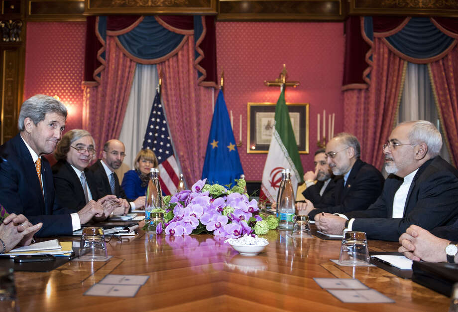 U.S. Secretary of State John Kerry, left, U.S. Secretary of Energy Ernest Moniz, second left,  National Security Council point person on the Middle East Robert Malley, 3rd left,  and European Union Political Director Helga Schmid. 4th left, head of the Iranian Atomic Energy Organisation Ali Akbar Salehi 2nd right,  and Iranian Foreign Minister Mohammad Javad Zarif right wait for the start of a meeting at a hotel in Lausanne  Switzerland on Thursday March 26, 2015 during negotiations on the Iranian nuclear programme.   (AP Photo/Brendan Smialowski, Pool) ORG XMIT: LON103 Photo: BRENDAN SMIALOWSKI / POOL AFP