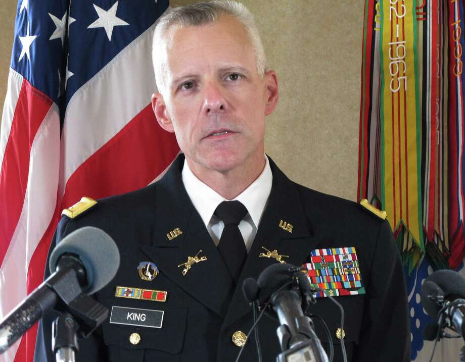 U.S. Army Col. Daniel King addresses the news media about charges against Army Sgt. Bowe Bergdahl at Fort Bragg, N.C., on Wednesday, March 25, 2015. Bergdahl, who abandoned his post in Afghanistan and was held captive for five years by the Taliban, was charged Wednesday by the U.S. military with desertion and misbehavior before the enemy and could get life in prison if convicted. (AP Photo/Allen G. Breed) ORG XMIT: NCAB301 Photo: Allen Breed / AP
