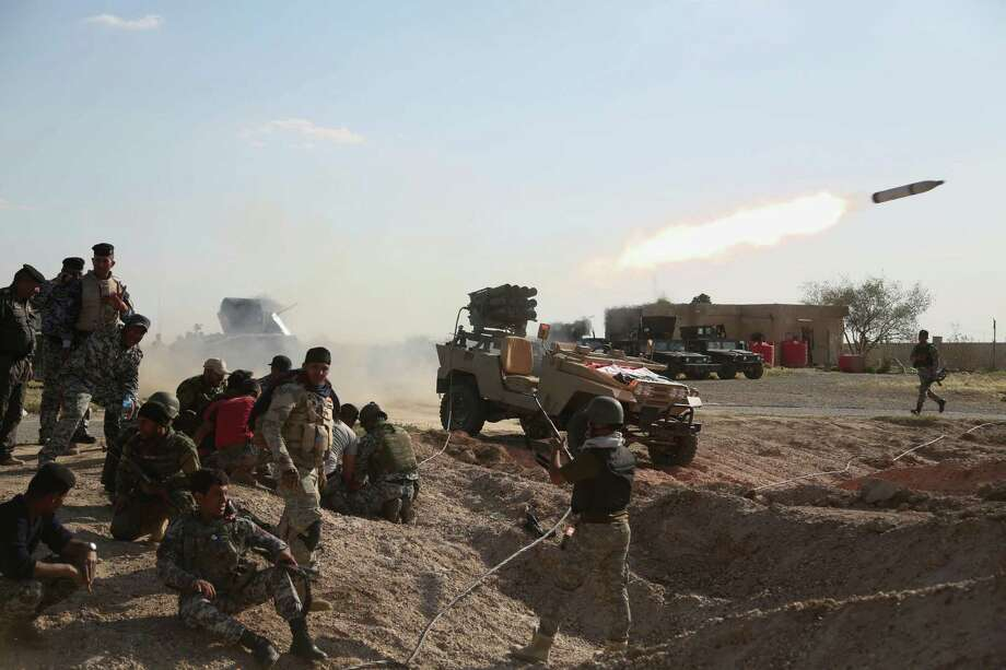 Iraqi security forces launch a rocket toward Islamic State extremist positions during clashes in Tikrit, 130 kilometers (80 miles) north of Baghdad, Iraq, Thursday, March 26, 2015. Iraqi troops started the final phase of an offensive to recapture Saddam Hussein's hometown of Tikrit on Thursday, a military official said, just hours after the United States launched airstrikes on the Islamic State held city. (AP Photo/Khalid Mohammed) ORG XMIT: BKM103 Photo: Khalid Mohammed / AP