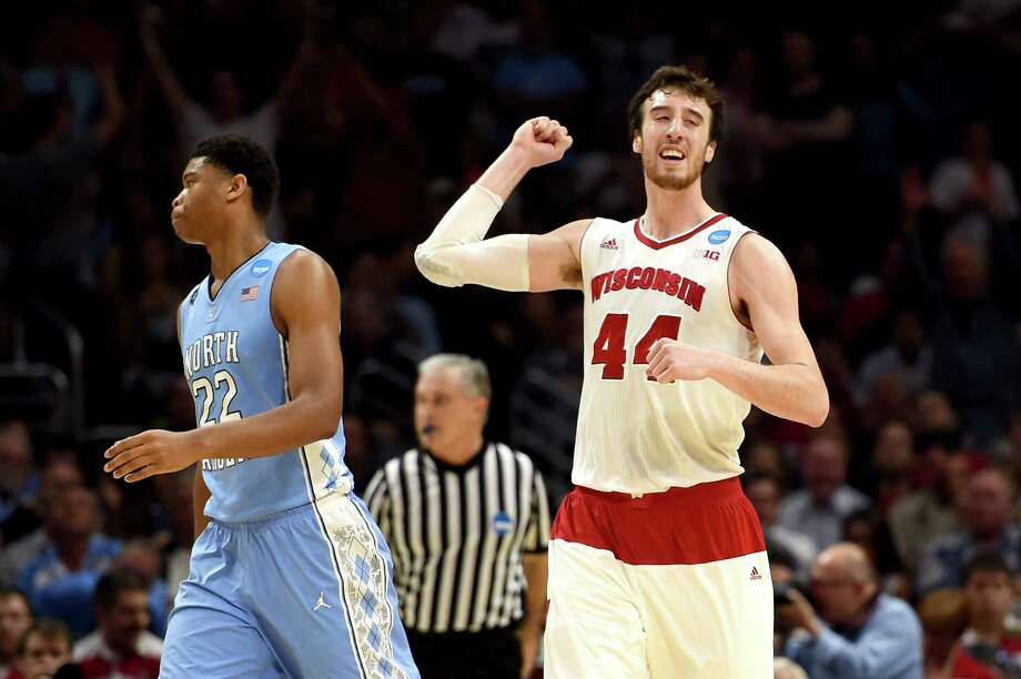 Despite getting hit in the eye during Thursday night's game, Wisconsin's Frank Kaminsky had the last laugh - a 79-72 victory over North Carolina. Photo: Harry How, Staff / 2015 Getty Images