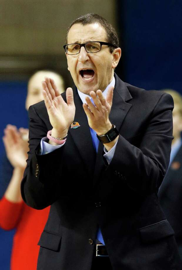 Dayton head coach Jim Jabir urges his team on during the first half of a women's college basketball game against Iowa State in the first round of the NCAA tournament in Lexington, Ky., Friday, March 20, 2015. (AP Photo/James Crisp) ORG XMIT: KYJC124 Photo: James Crisp / FR6426 AP