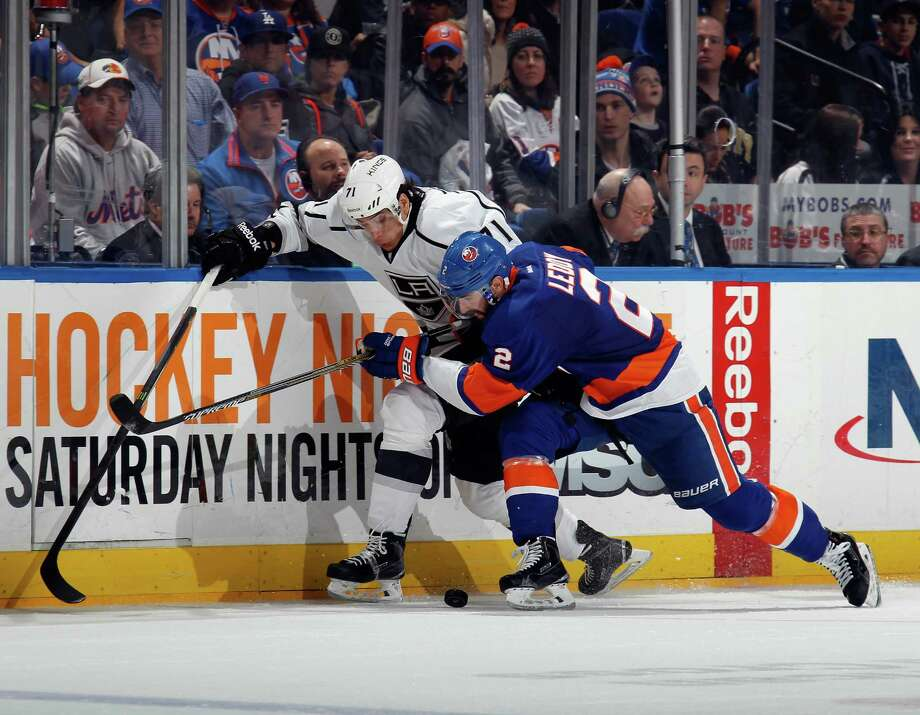 UNIONDALE, NY - MARCH 26: Anze Kopitar #11 of the Los Angeles Kings is checked by Nick Leddy #2 of the New York Islanders during the third period at the Nassau Veterans Memorial Coliseum on March 26, 2015 in Uniondale, New York. The Kings defeated the Islanders 3-2. (Photo by Bruce Bennett/Getty Images) ORG XMIT: 507051113 Photo: Bruce Bennett / 2015 Getty Images