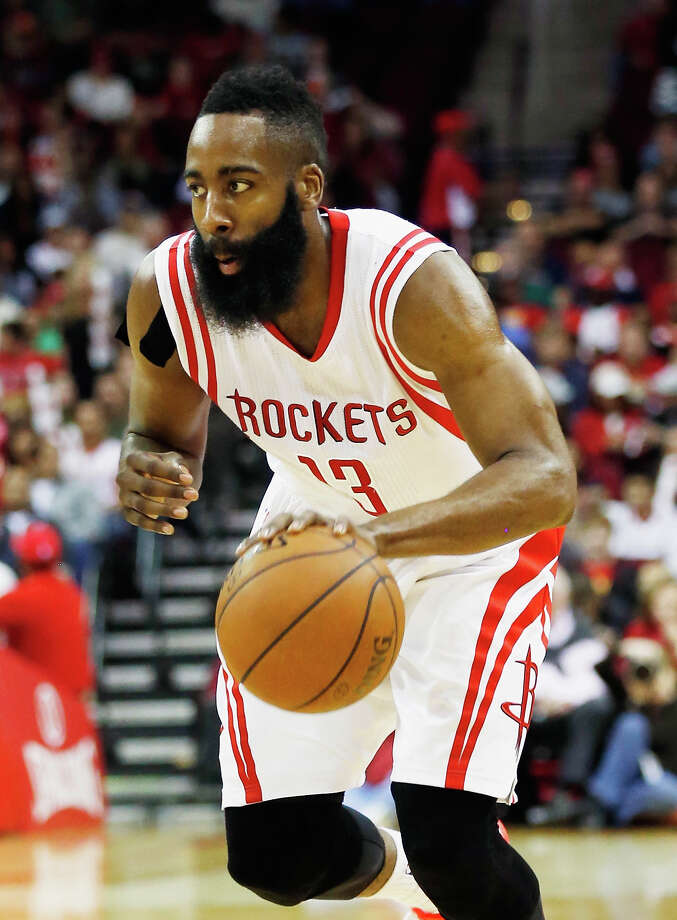 HOUSTON, TX - MARCH 21:  James Harden #13 of the Houston Rockets drives with the basketball during their game against the Phoenix Suns at the Toyota Center on March 21, 2015 in Houston, Texas. NOTE TO USER: User expressly acknowledges and agrees that, by downloading and/or using this photograph, user is consenting to the terms and conditions of the Getty Images License Agreement.  (Photo by Scott Halleran/Getty Images) ORG XMIT: 508087509 Photo: Scott Halleran / 2015 Getty Images