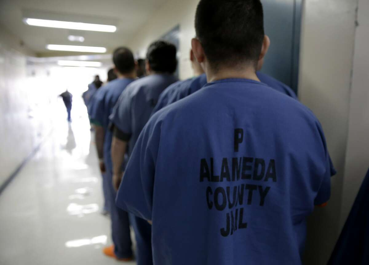 Inmates lines up to be taken to the Sandy Turner Education Center for class at the Santa Rita Jail in Dublin, Calif., on Thurs. Mar. 26, 2015. The Alameda County Sheriff is challenging the Board of Supervisors over a new plan to strip money away from law enforcement and redistribute it to community organizations.