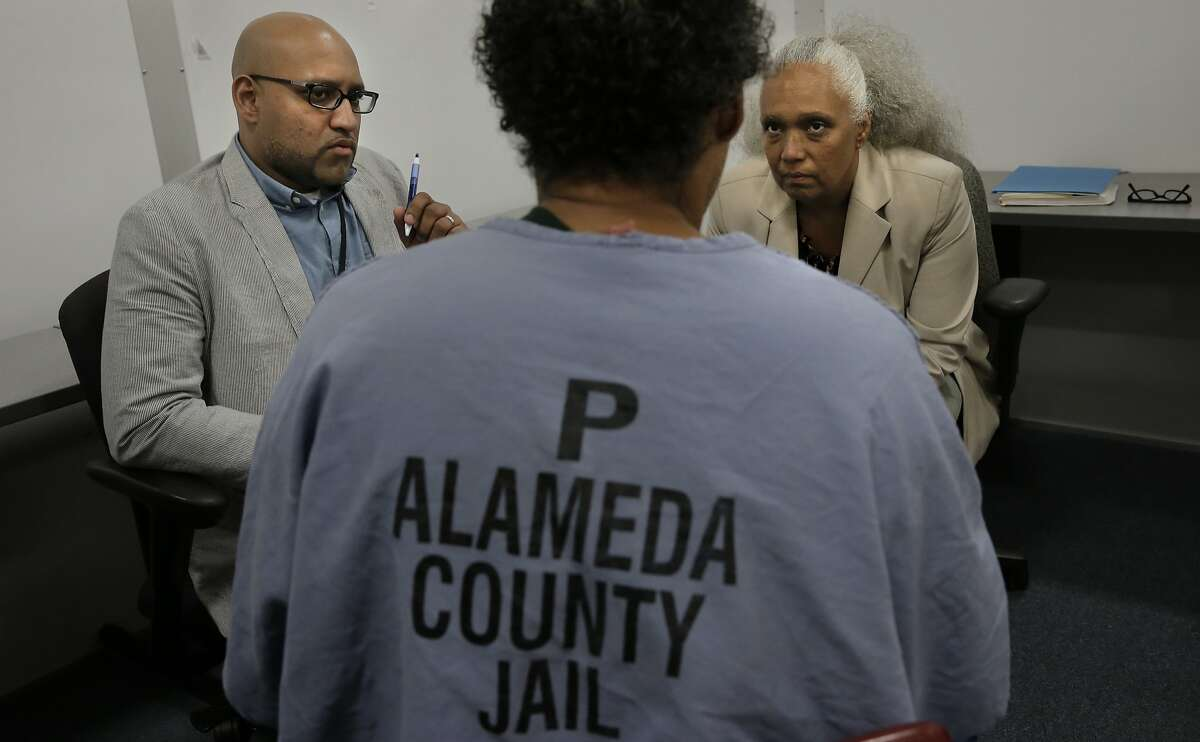 Case managers Kunjal Joshi and Ellen Davis talk with an inmate about his transition out of Santa Rita Jail in Dublin, Calif., on Thurs. Mar. 26, 2015. The Alameda County Sheriff is challenging the Board of Supervisors over a new plan to strip money away from law enforcement and redistribute it to community organizations.