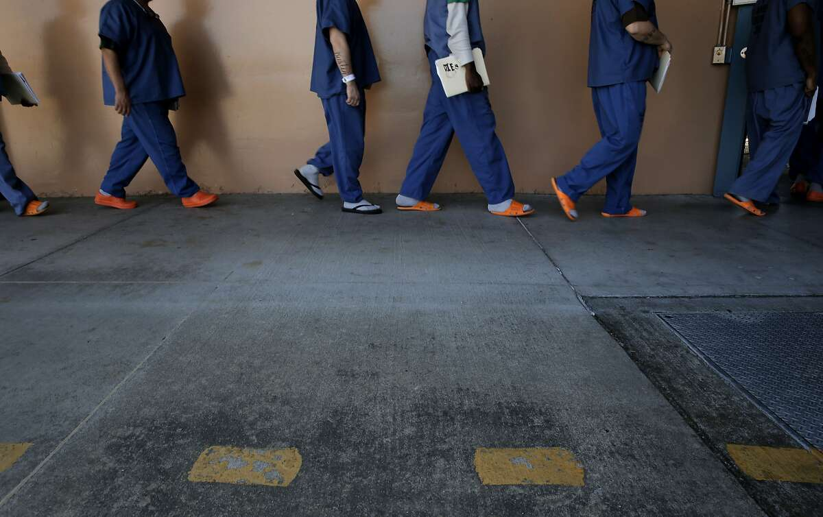 Inmates walk to the Sandy Turner Education Center for class at the Santa Rita Jail in Dublin, Calif., on Thurs. Mar. 26, 2015. The Alameda County Sheriff is challenging the Board of Supervisors over a new plan to strip money away from law enforcement and redistribute it to community organizations.