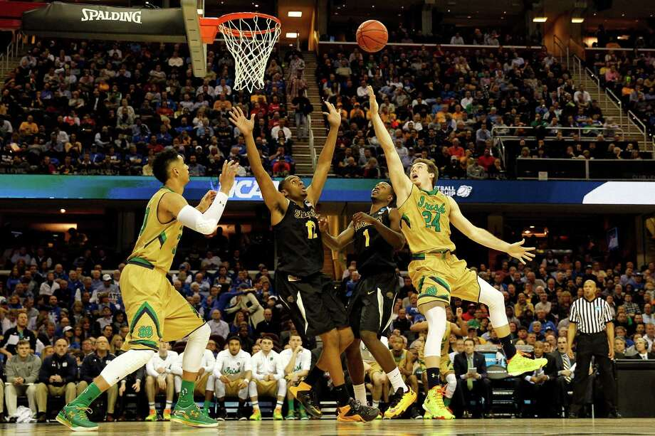 CLEVELAND, OH - MARCH 26: Pat Connaughton #24 of the Notre Dame Fighting Irish drives to the basket against Darius Carter #12 of the Wichita State Shockers in the second half during the Midwest Regional semifinal of the 2015 NCAA Men's Basketball Tournament at Quicken Loans Arena on March 26, 2015 in Cleveland, Ohio.  (Photo by Gregory Shamus/Getty Images) ORG XMIT: 527066269 Photo: Gregory Shamus / 2015 Getty Images
