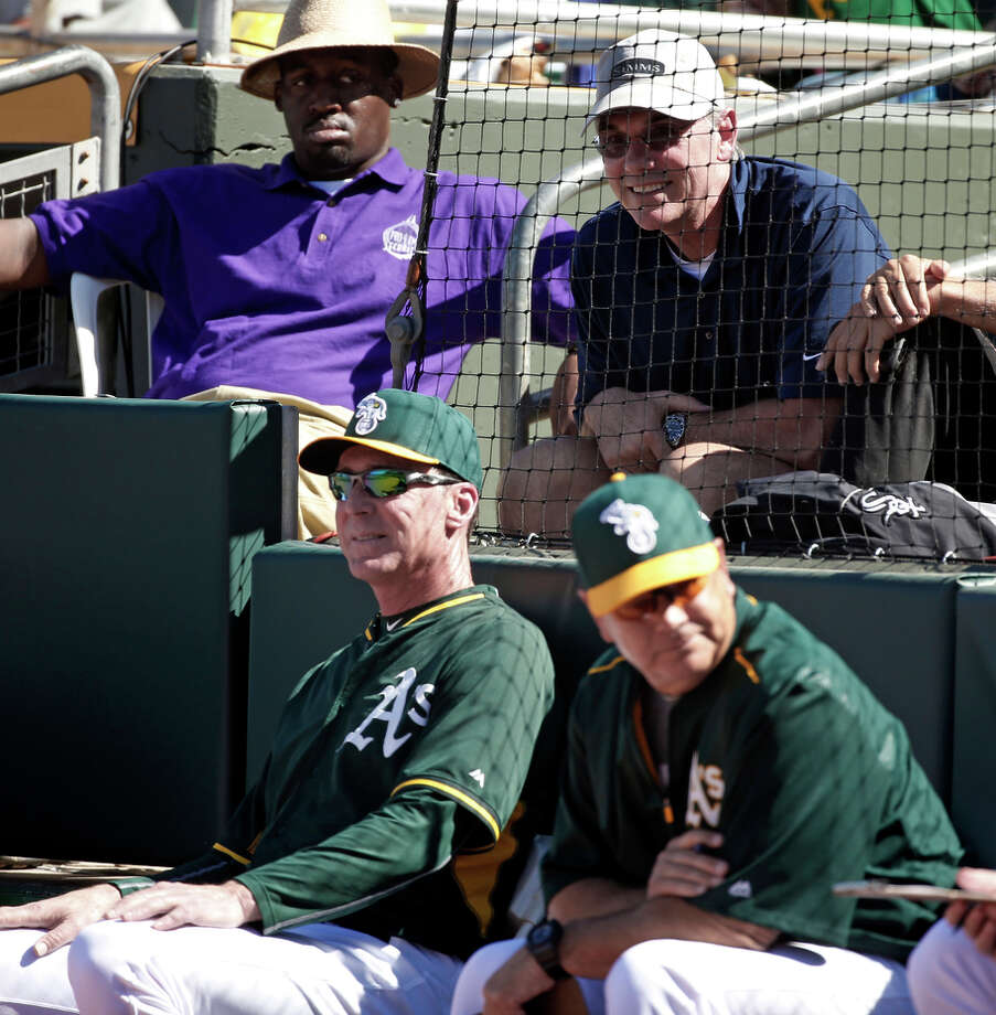 A's general manager Billy Beane (back row, right), watching a Cactus League game, is not to be confused with Billy Bean. Photo: Scott Strazzante / The Chronicle / ONLINE_YES