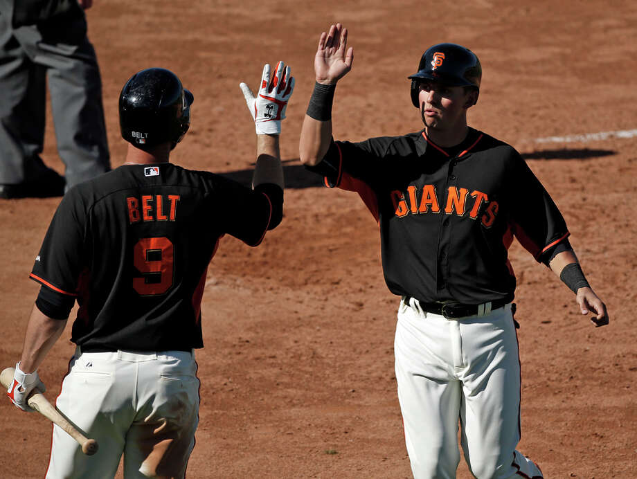 Joe Panik's successful offensive moments, like the one above, have been minimal this spring. He's hitting only .160. Photo: Scott Strazzante / The Chronicle / ONLINE_YES