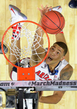 Bishop O'Dowd alum Brandon Ashley dunks for two of his eight points in Arizona's win over Xavier.
