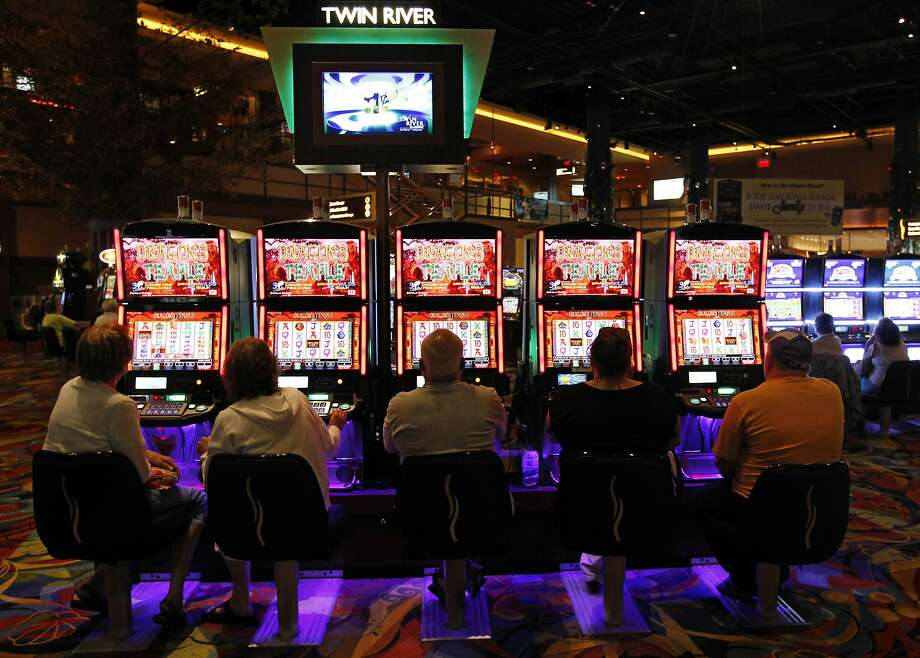 In this July 12, 2011, file photo, patrons play slot machines at the Twin River Casino, in Lincoln, R.I.  Photo: Steven Senne, Associated Press