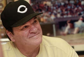 Pete Rose, who has submitted a new request to be reinstated to baseball, signs autographs at a mall in Indianapolis in 2011.