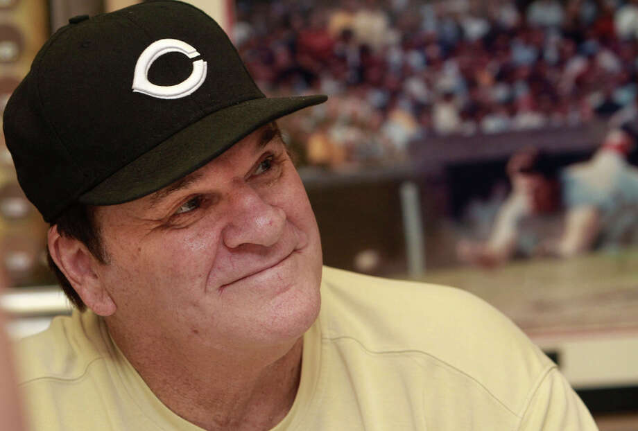 Pete Rose, who has submitted a new request to be reinstated to baseball, signs autographs at a mall in Indianapolis in 2011. Photo: Charlie Nye / Associated Press / The Indianapolis Star
