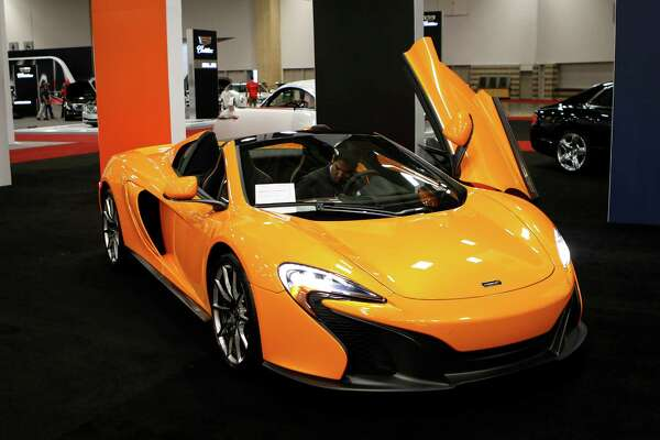 Isaac Villarreal parks a McLaren MSO 650S, which is priced starting at $280,225, in the High End section of the 2015 DFW Auto Show in Dallas on Monday, March 23, 2015. (Jim Tuttle/Dallas Morning News/TNS)