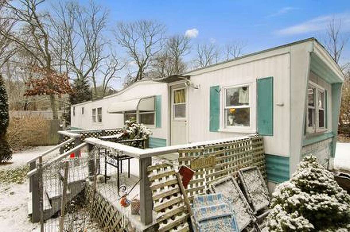 This rather rundown trailer house that sits in the middle of the posh Hamptons is listed for $1.2 million, up by $100,000 from last month. The house's large price tag may leave people scratching their heads in confusion, but it's location near the popular Indian Wells Beach actually makes it seem like a bargain. Next door, a home just sold for $4 million. Source: Douglas Elliman Real Estate