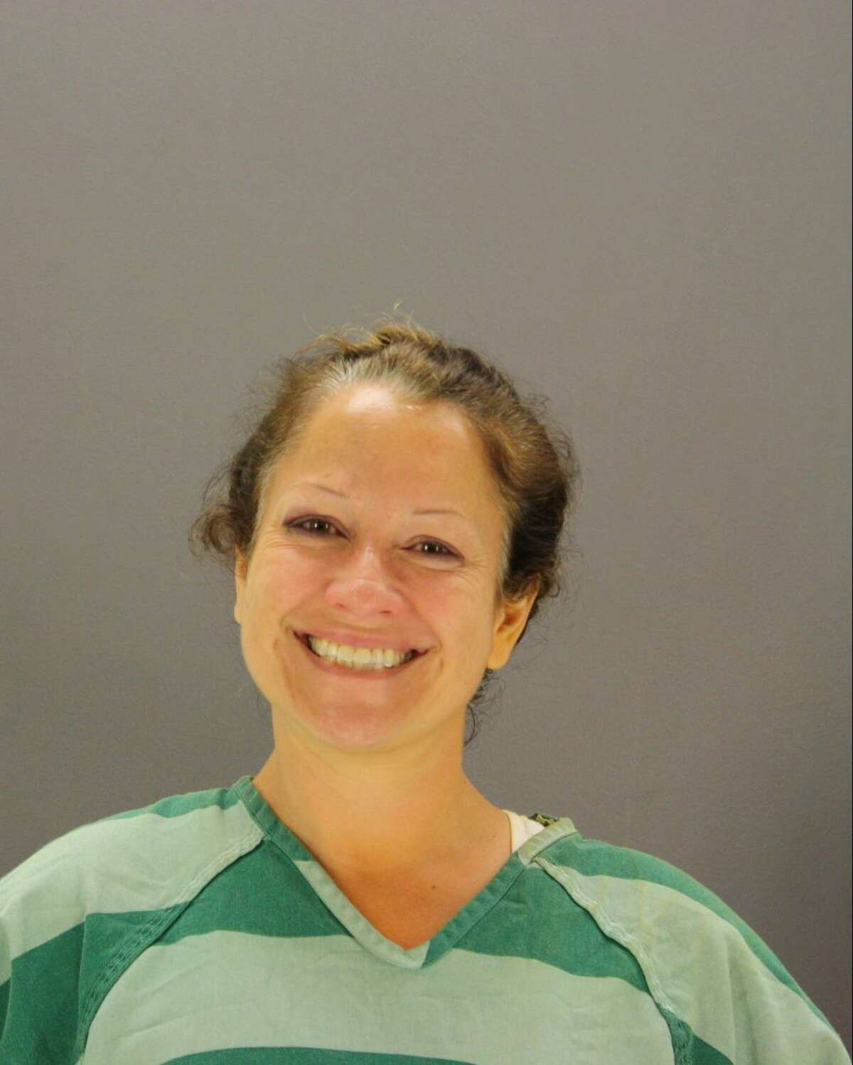 Dallas woman Nancy Suzanne Duarte, whose smiling mugshot made the rounds on social media this week, tried to burn down a yoga studio Saturday in order to