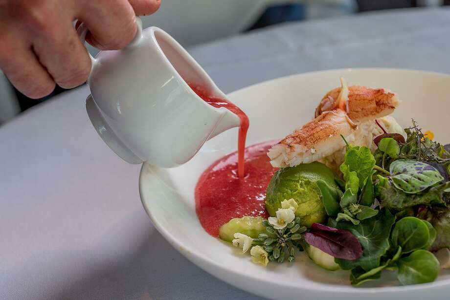 Dressing being poured on the Dungeness Crab salad at Boulevard in  San Francisco, Calif., is seen on March 26th , 2015. Photo: John Storey