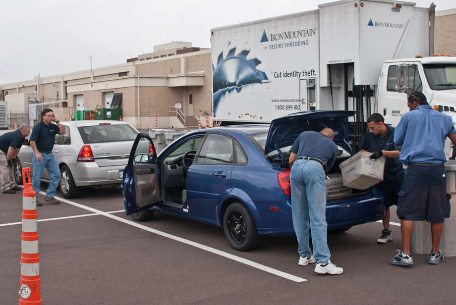 Comerica Bank and Iron Mountain are hosting their fifth-annual Shred Day Houston on April 8. This photo, provided by Comerica, is of Shred Day in 2013.