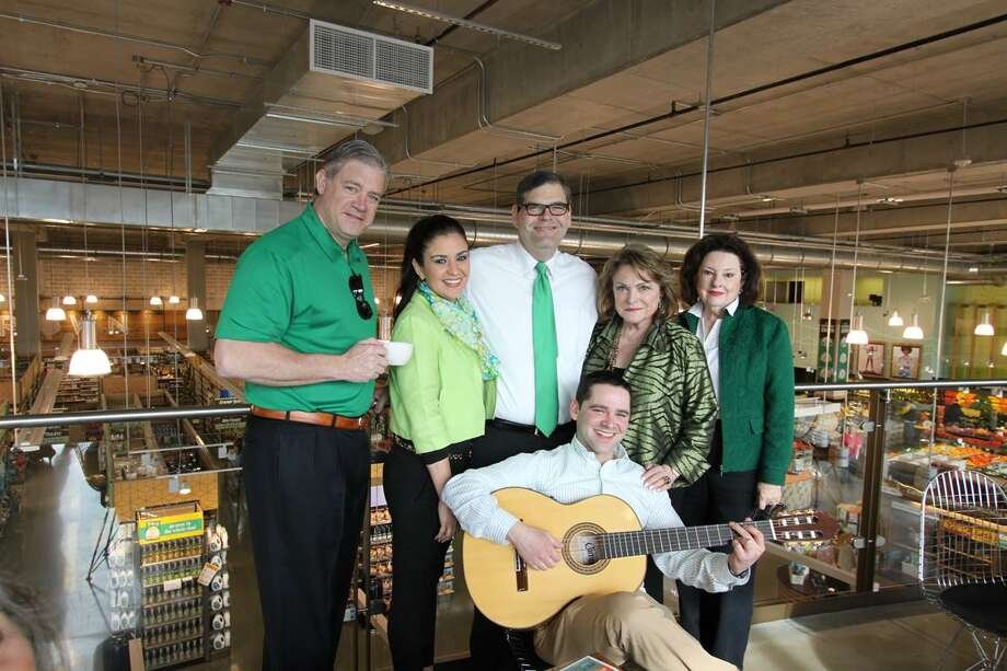 Seth Caplan (with guitar) penned a tune about his Beth Wolff Realtors colleagues and debuted it at a recent sales meeting. Sharing in the morning were (left to right) Shayne Stinson, Jennifer Jacks, Ed Wolff, Beth Wolff and Muriel Mendell