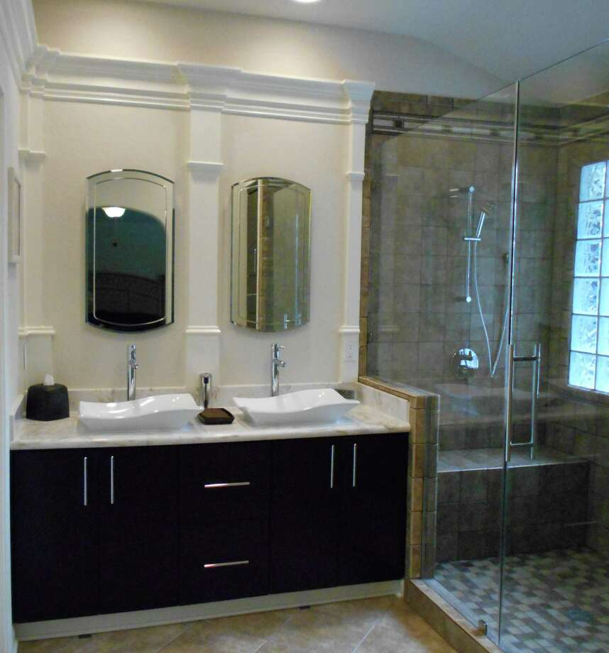 This bathroom remodel was done by JRG Builder and Remodelers. Photo: Courtesy Of JRG Builder And Remodelers