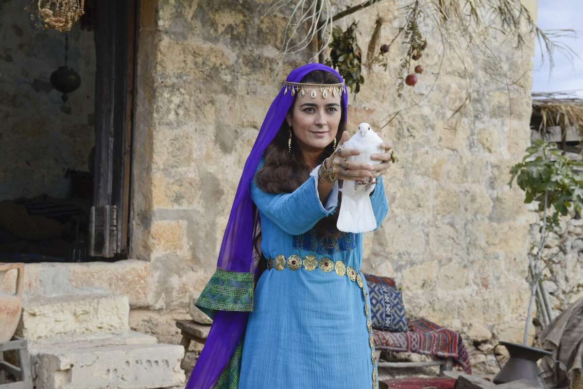 Cote de Pablo, as Shirah, sends a message via a dove in 'The Dovekeepers' on CBS.