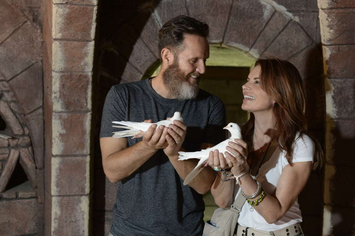 """Executive producers Roma Downey and Mark Burnett handle a couple of the doves used in """"The Dovekeepers"""" on CBS."""